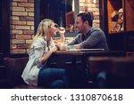beautiful couple on a romantic... | Shutterstock . vector #1310870618