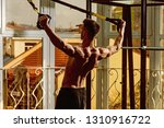 sport and gym concept. man with ... | Shutterstock . vector #1310916722