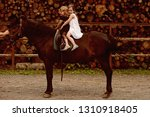 girls ride on horse on summer... | Shutterstock . vector #1310918405