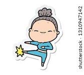 sticker of a cartoon peaceful... | Shutterstock .eps vector #1310947142