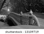 Snowfall Covers A Bridge In...