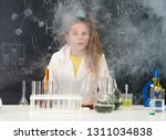 excited schoolgirl in fume... | Shutterstock . vector #1311034838