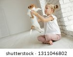 child with a dog | Shutterstock . vector #1311046802