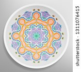 decorative plate with round... | Shutterstock .eps vector #1311076415