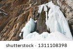 Frozen Waterfall Among The...