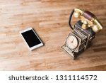 new and old telephone on the... | Shutterstock . vector #1311114572
