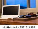 working at home with laptop on... | Shutterstock . vector #1311114578