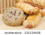 assortment of baked bread on... | Shutterstock . vector #131124428