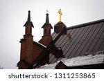 cross and spire of finlaysonin... | Shutterstock . vector #1311253865