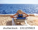 beautiful woman sunbathing on a ... | Shutterstock . vector #1311255815