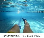 man swimming underwater in pool ...   Shutterstock . vector #1311314432