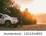 woman standing near white suv... | Shutterstock . vector #1311314855