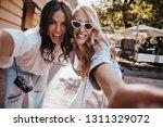 fashionable latin girl making... | Shutterstock . vector #1311329072