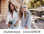 lovely brunette girl with... | Shutterstock . vector #1311329078