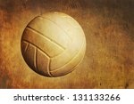 a volleyball sits on a grunge... | Shutterstock . vector #131133266