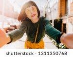 charming caucasian girl in... | Shutterstock . vector #1311350768