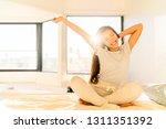 morning woman waking up... | Shutterstock . vector #1311351392