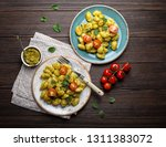 gnocchi in plates with green... | Shutterstock . vector #1311383072
