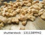 cooking cubed bite size chicken ... | Shutterstock . vector #1311389942