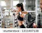 beautiful athletic girl dressed ... | Shutterstock . vector #1311407138