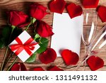 red roses with a gift and... | Shutterstock . vector #1311491132
