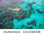 happy girl in snorkeling mask... | Shutterstock . vector #1311568208