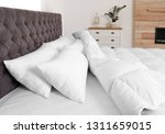 large comfortable bed in light... | Shutterstock . vector #1311659015