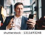young attractive businessman... | Shutterstock . vector #1311693248