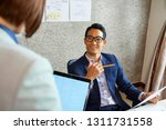 young smiling asian businessman ... | Shutterstock . vector #1311731558