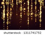 golden bokeh sparkle glitter... | Shutterstock .eps vector #1311741752
