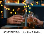 couple drinking whiskey in bar | Shutterstock . vector #1311751688