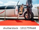 driver helping vip woman or... | Shutterstock . vector #1311759668