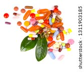 colorful tablets with capsules | Shutterstock . vector #1311903185