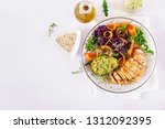 buddha bowl dish with chicken... | Shutterstock . vector #1312092395