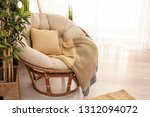 cozy armchair in modern light... | Shutterstock . vector #1312094072
