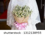 lovely bride holding a bouquet... | Shutterstock . vector #1312138955
