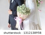 lovely bride holding a bouquet... | Shutterstock . vector #1312138958