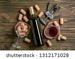bottle and glass of red wine... | Shutterstock . vector #1312171028