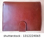 brown men's wallet from genuine ... | Shutterstock . vector #1312224065