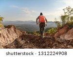 tourist on the peak of high... | Shutterstock . vector #1312224908