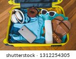 travel concept. yellow suitcase ...   Shutterstock . vector #1312254305