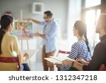 group of young learners making... | Shutterstock . vector #1312347218