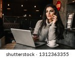 beautiful woman working with... | Shutterstock . vector #1312363355