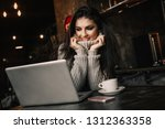 beautiful woman working with... | Shutterstock . vector #1312363358