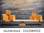 Small photo of Two piles of boxes on the scales. Trade balance and calculation by barter. Bypassing sanctions, import and export of goods. Trade balance. Goods turnover between two subjects or countries.