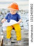 portrait of cute little builder ... | Shutterstock . vector #1312405802