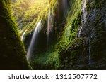 beautiful scene of waterfall in ...   Shutterstock . vector #1312507772
