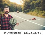 Smiling Hitchhiker On Road ...