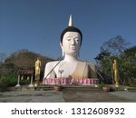 big buddha statue half body of... | Shutterstock . vector #1312608932