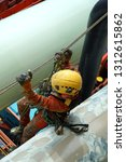 working at height. an abseiler... | Shutterstock . vector #1312615862